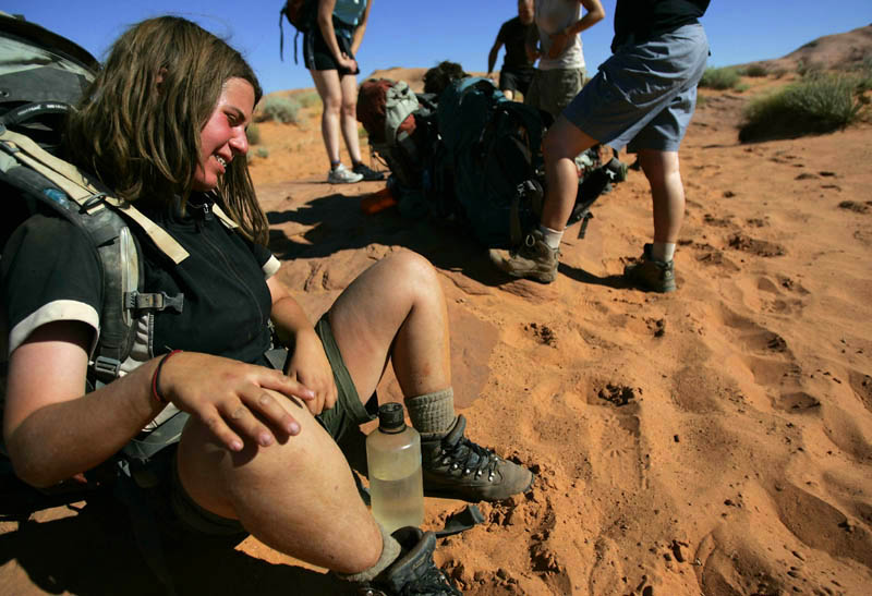 Teens and guides from Aspiro hike across the desert to Coyote Gulch and the Escalante River Thursday, July 31, 2008. Aspiro is an adventure therapy program for troubled teens. The group from Aspiro hiked five miles into Coyote Gulch and the Escalante River in the Glen Canyon Recreation Area where they were to spend about a week.  -- 7/31/08 (Jim Urquhart/The Salt Lake Tribune)