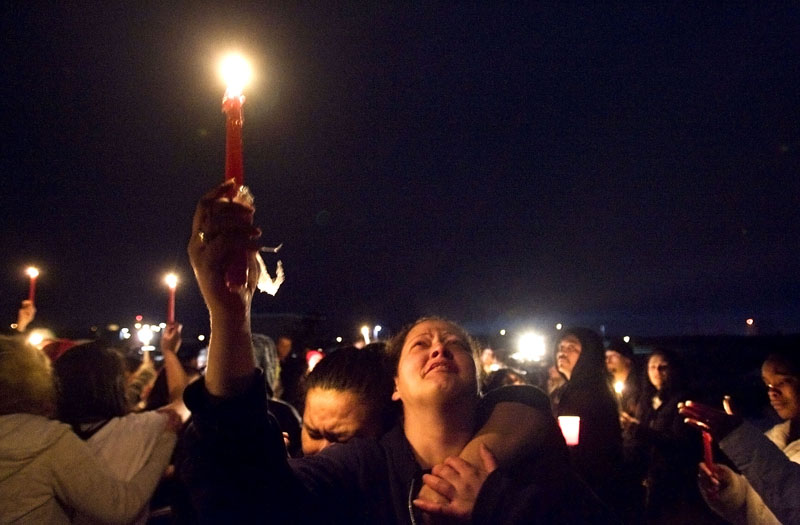 Enga Valasi, right, an aunt of JoJo Lee Brandstatt, mourns and calls out with her sister-in-law Elena Faauli, left, during a candle light vigil for JoJo Lee Brandstatt Saturday, February 7, 2009 at the West Ridge golf course in West Valley. JoJo Lee Brandstatt, 18, was found dead on the West Ridge golf course early Friday morning. He had been kidnapped and murdered. Jim Urquhart/The Salt Lake Tribune; 2/07/09