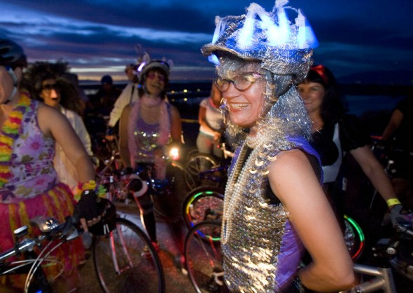 Alesia Stripeika (cq) of Salt Lake City dressed in a colorful costume for the 16th Annual Antelope by Moonlight Bike Ride Friday, July 10, 2009 on Antelope Island. Proceeds from the 22-mile ride that took more that 1,000 riders from Antelope Island Marina to the historic Fielding Garr Ranch and back go to Antelope Island State Park projects. Jim Urquhart/The Salt Lake Tribune; 7/10/09