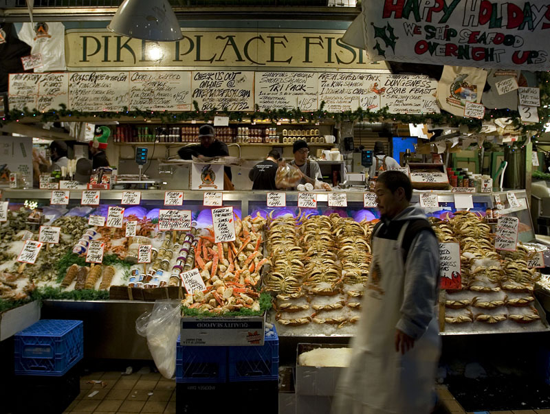 The Pike Place Fish Market and the Fish Mongers at the Pike Place Market in Seattle, Washington. 12/22/2009 - Jim Urquhart/Straylighteffect.com