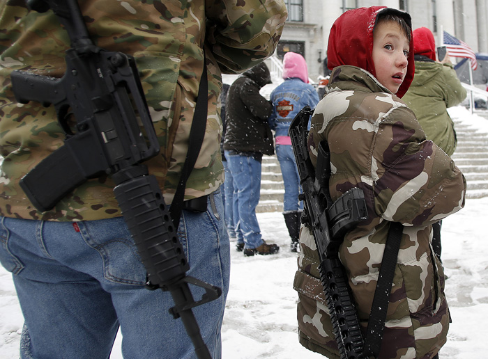 Clint McQueen and his son Chance McQueen , 7, carry rifles at a pro gun activist rally as part of the National Day of Resistance at the state Capitol in Salt Lake CIty, Utah February 23, 2013.  REUTERS/Jim Urquhart  (UNITED STATES)