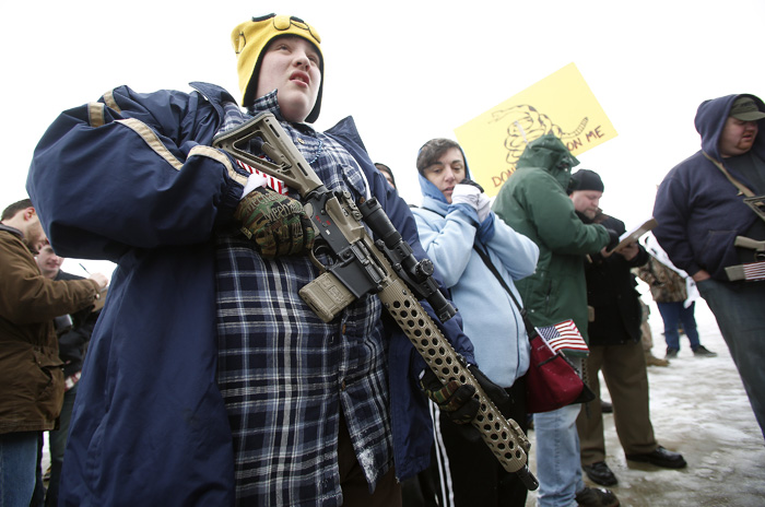 Chris Harris, 13, carries an AR-15 rifle at a pro gun activist rally as part of the National Day of Resistance at the state Capitol in Salt Lake CIty, Utah, February 23, 2013.  REUTERS/Jim Urquhart  (UNITED STATES)