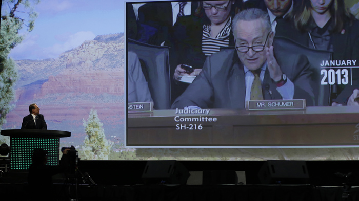 A video clip of U.S. Senator Charles E. Schumer from New York is played as Executive Vice President of the National Rifle Association Wayne LaPierre gives the keynote address at the Western Hunting and Conservation Expo in Salt Lake CIty, Utah, February 23, 2013.  REUTERS/Jim Urquhart  (UNITED STATES)