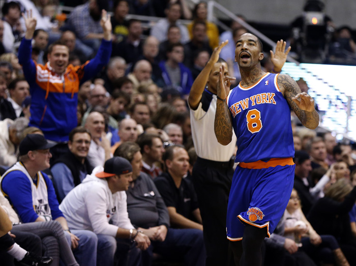 New York Knicks guard J.R. Smith (8) reacts after hitting a shot during the second half of their NBA basketball game against the Utah Jazz in Salt Lake City, Utah, March 18, 2013. REUTERS/Jim Urquhart (UNITED STATES)