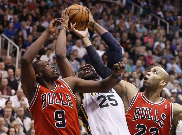 Utah Jazz center Al Jefferson (25)  and Chicago Bulls forwards Luol Deng (9) and forward Taj Gibson (22) fight for a rebound during the second half of their NBA basketball game in Salt Lake City, Utah, Utah, February 8, 2013. REUTERS/Jim Urquhart (UNITED STATES)