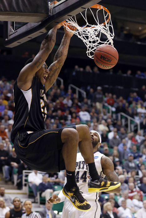 Wichita State forward Carl Hall (22) gets a dunk past Pittsburgh forward J.J. Moore (44) during the second half of their second round NCAA tournament basketball game in Salt Lake City, Utah, March 21, 2013. REUTERS/Jim Urquhart (UNITED STATES)