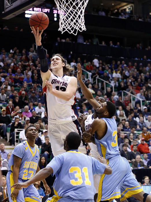 Gonzaga forward Kelly Olynyk (13) shoots over Southern University guards YonDarius Johnson (23),  Christopher Hyder (31) and center Brandon Moore (32) during the second half of their second round NCAA tournament basketball game in Salt Lake City, Utah, March 21, 2013. REUTERS/Jim Urquhart (UNITED STATES)