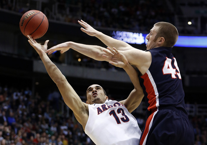 Arizona guard Nick Johnson (13) takes a shot while defended by Belmont forward Brandon Baker (45) during the second half of their second round NCAA tournament basketball game in Salt Lake City, Utah, March 21, 2013. REUTERS/Jim Urquhart (UNITED STATES)