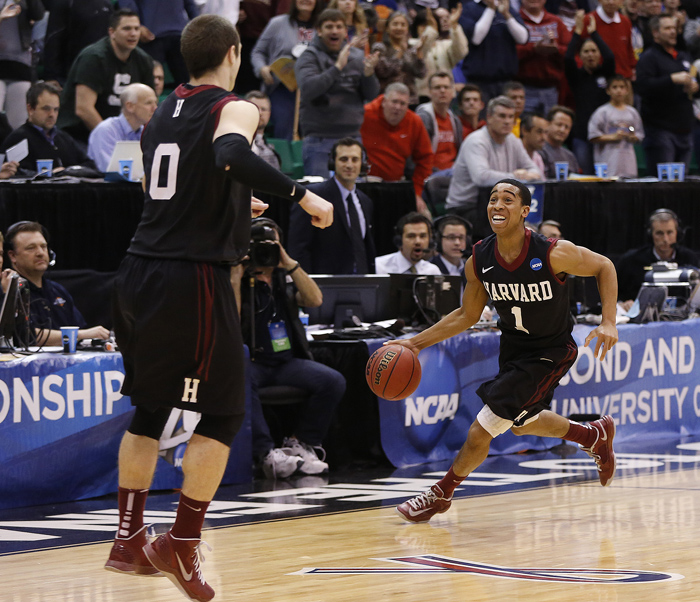 Harvard guards Siyani Chambers (1) and Laurent Rivard (0) begin to celebrate as time winds down during the second half of their second round NCAA tournament basketball game against New Mexico in Salt Lake City, Utah, March 21, 2013. REUTERS/Jim Urquhart (UNITED STATES)