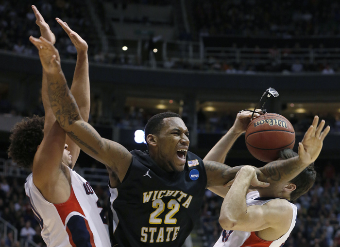 Wichita State forward Carl Hall (22) loses his glasses while defended by Gonzaga forward Elias Harris (20) and guard Drew Barham (43) during the second half of their third round NCAA tournament basketball game in Salt Lake City, Utah, March 23, 2013. REUTERS/Jim Urquhart (UNITED STATES)