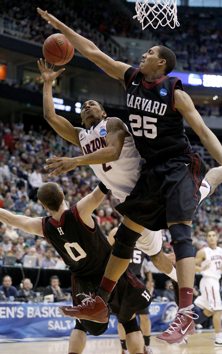 Arizona guard Mark Lyons (2) drives for a shot while defended by Harvard guard Laurent Rivard (0) and center Kenyatta Smith (25) during the second half of their third round NCAA tournament basketball game in Salt Lake City, Utah, March 23, 2013. REUTERS/Jim Urquhart (UNITED STATES)