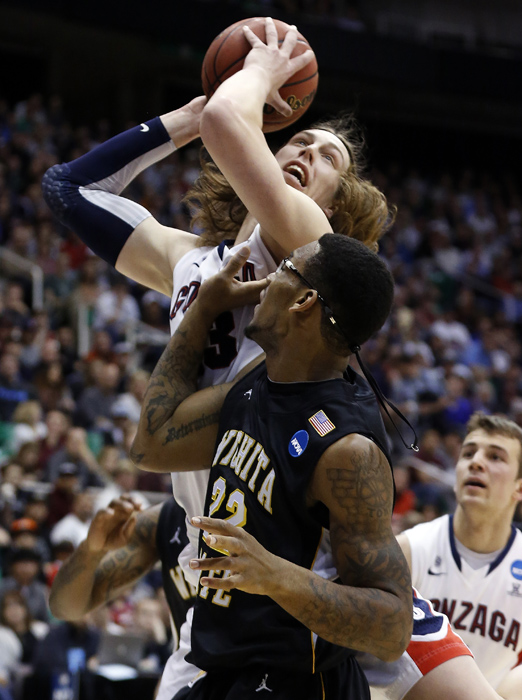 Gonzaga forward Kelly Olynyk (13) attempts a shot while defended by Wichita State forward Carl Hall (22) during the first half of their third round NCAA tournament basketball game in Salt Lake City, Utah, March 23, 2013. REUTERS/Jim Urquhart (UNITED STATES)