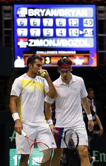 Serbia's Nenad Zimonjic, left, and Ilija Bozoljac before defeating United States' Mike Bryan and Bob Bryan during their Davis Cup doubles quarter-final tennis match in Boise, Idaho, April 6, 2013. REUTERS/Jim Urquhart (UNITED STATES)