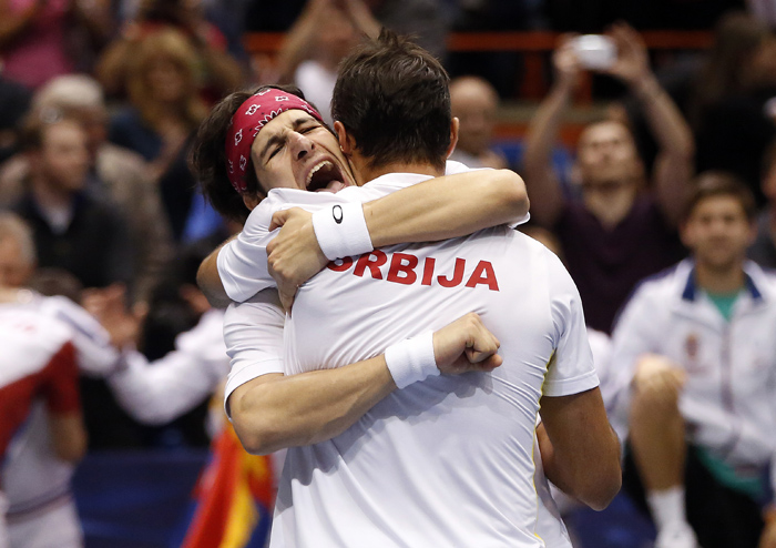 Serbia's Ilija Bozoljac, left, and Nenad Zimonjic celebrate after defeating United States' Mike Bryan and Bob Bryan during their Davis Cup doubles quarter-final tennis match in Boise, Idaho, April 6, 2013. REUTERS/Jim Urquhart (UNITED STATES)