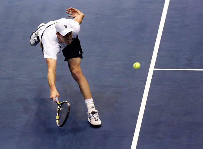 United States' Sam Querrey hits a return to Serbia's Viktor Troicki during their Davis Cup quarter-final tennis match in Boise, Idaho, April 5, 2013. REUTERS/Jim Urquhart (UNITED STATES)