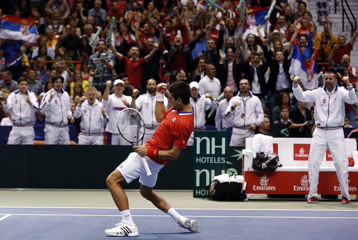 Serbia's Novak Djokovic reacts after defeating United States' John Isner during their Davis Cup quarter-final tennis match in Boise, Idaho, April 5, 2013. REUTERS/Jim Urquhart (UNITED STATES)