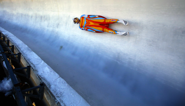 Kate Hansen makes her way down the track during the United States luge team trials Sunday Oct. 20, 2013, in Park City, Utah. (AP Photo/Jim Urquhart)