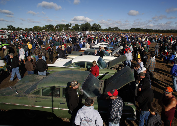 Potential buyers and car enthusiast check out the vintage automobiles from the Lambrecht Collection before being put up for auction in Pierce, Nebraska, September 28, 2013. Over 500 classic cars and trucks from an inventory collected by Ray and Mildred Lambrecht will be sold over the weekend. REUTERS/Jim Urquhart  (UNITED STATES)