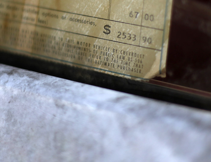 The original price sticker is still visible on a 1963 Corvair that originally sold for $2533.90 that is part of the vintage automobiles from the Lambrecht Collection before being put up for auction in Pierce, Nebraska, September 28, 2013. Over 500 classic cars and trucks from an inventory collected by Ray and Mildred Lambrecht will be sold over the weekend. REUTERS/Jim Urquhart  (UNITED STATES)
