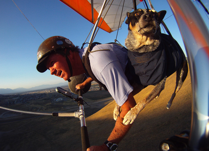 Dan McManus and his service dog Shadow hang glide together outside Salt Lake City, Utah