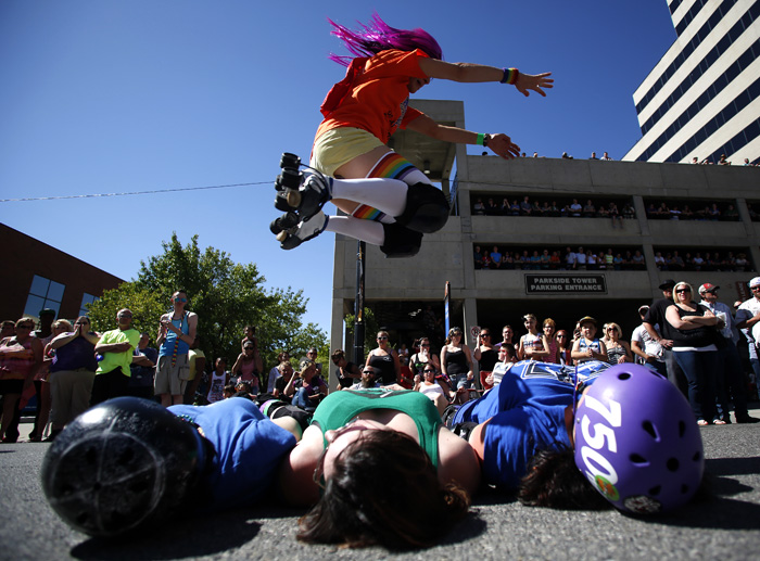 Roller skaters perform during a gay pride parade in Salt Lake City, Utah, June 2, 2013. Both active Mormons and members of the Boy Scouts marched with members of LGBT community and their supporters as part of the Utah Pride Festival. REUTERS/Jim Urquhart (UNITED STATES)