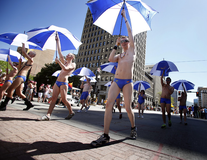 Members of Queer Utah Aquatic Club dance in a gay pride parade in Salt Lake City, Utah, June 2, 2013. Both active Mormons and members of the Boy Scouts marched with members of LGBT community and their supporters as part of the Utah Pride Festival. REUTERS/Jim Urquhart (UNITED STATES)