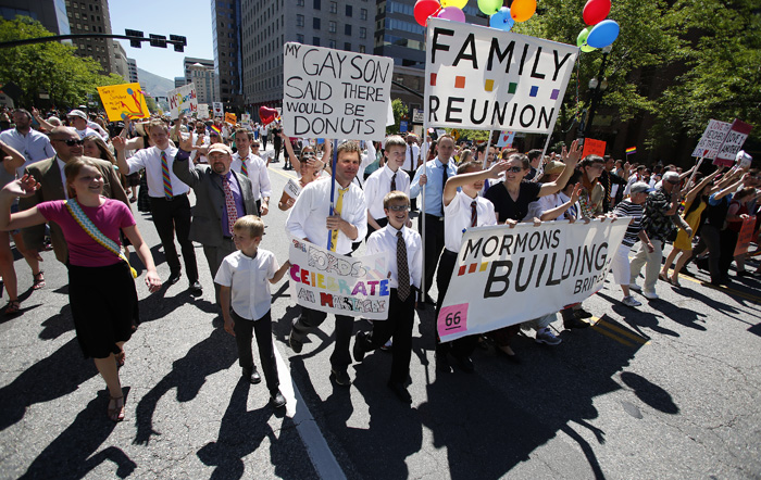 Members of the Mormon church march in a gay pride parade in Salt Lake City, Utah, June 2, 2013. Both active Mormons and members of the Boy Scouts marched with members of LGBT community and their supporters as part of the Utah Pride Festival. REUTERS/Jim Urquhart (UNITED STATES)