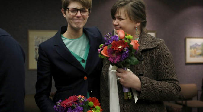 Natalie Dicou, left, and her partner Nicole Christensen wait to get married at the Salt Lake County Clerks office in Salt Lake  City, Utah, December 20, 2013. A U.S. federal judge struck down Utah's ban on same-sex marriage on December 20, 2013 in a ruling that found the prohibition violated the U.S. Constitution, potentially clearing the way for the state to become the 18th in the nation to allow gay marriage. REUTERS/Jim Urquhart
